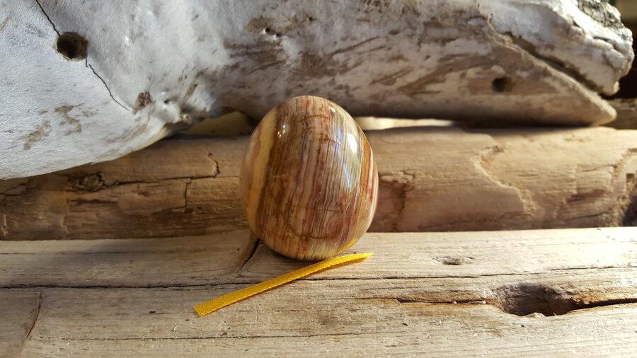 """Oniksa ola """"Pret stresu"""" Izmērs 4.5 x 4 cm Pakistānas raktuves Dzeltena bantīte"""