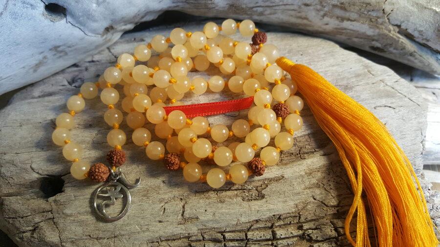 Dzeltena kalcīta krelles-mala nr 2. Bumbiņas 6 mm Oranža bantīte